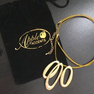 Golden pendant necklace by Apple Accents